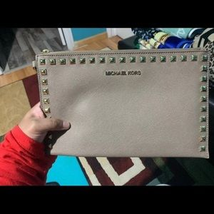 Two Michael Kors wristlets